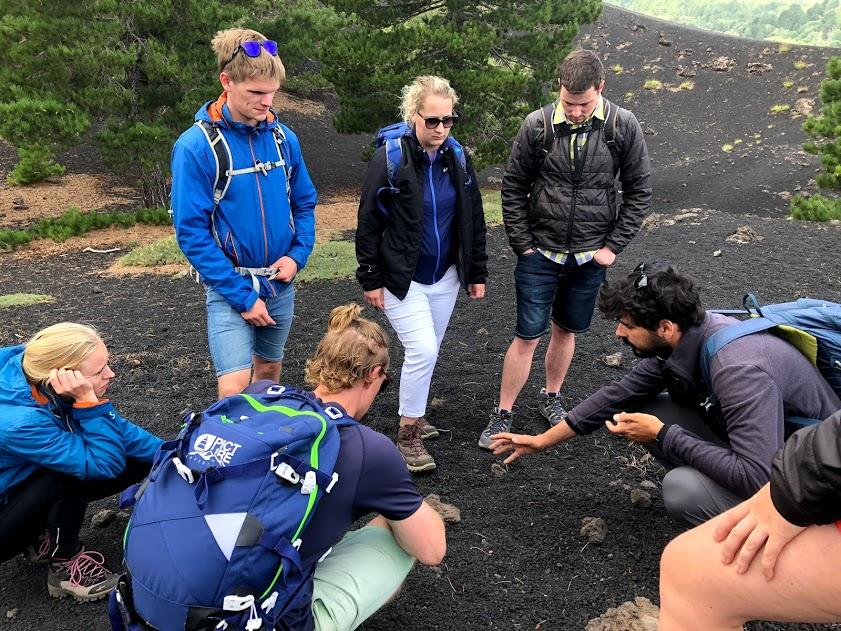 trekking with guide explaining